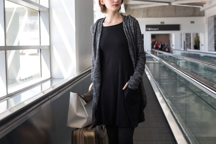 Woman in airport with betabrand sweatshirt travel dress black