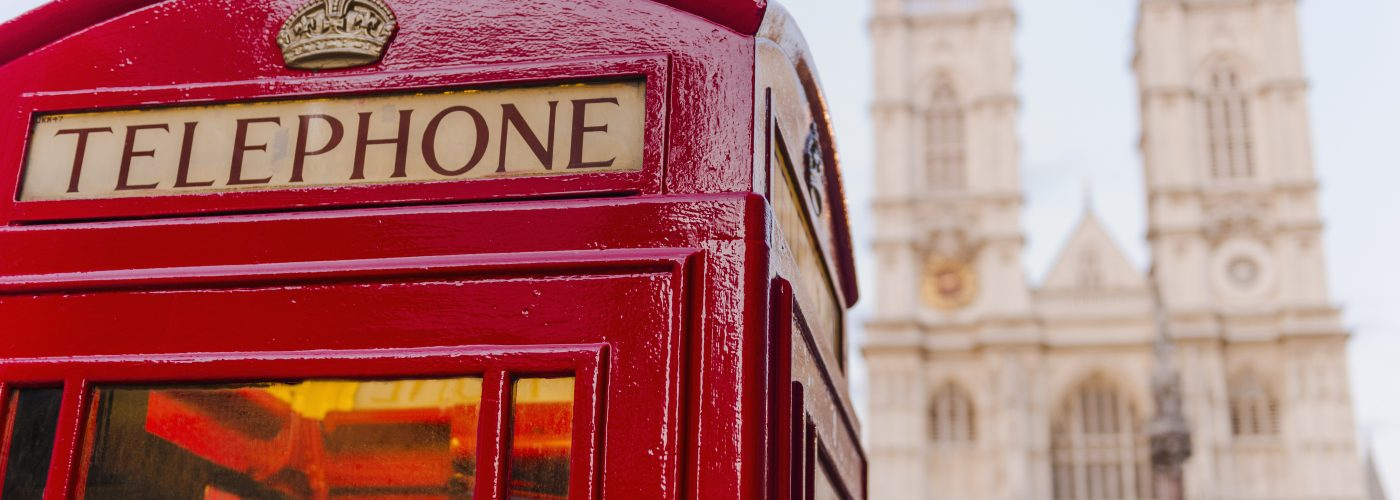 UK, London, Phone booth with Westminster Abbey behind DO NOT USE