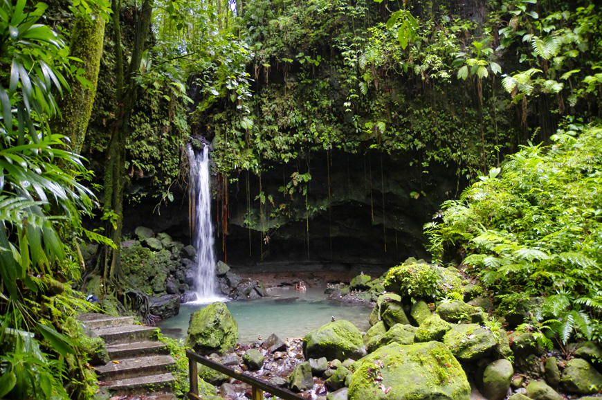 People take bath in Emerald Pool near waterfall Central Forest Reserve. Dominica island, Lesser Antilles