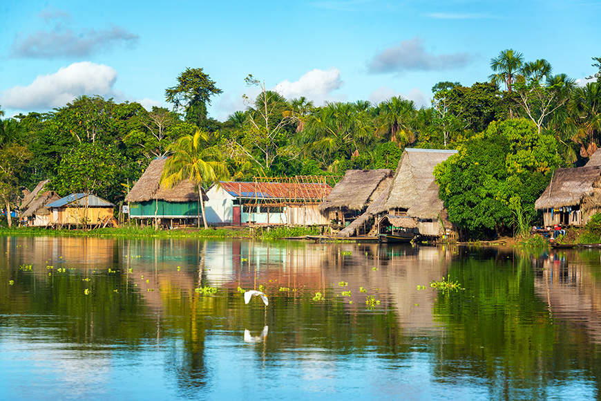 View of a small village in the Amazon rain forest on the shore of the Yanayacu River in Peru