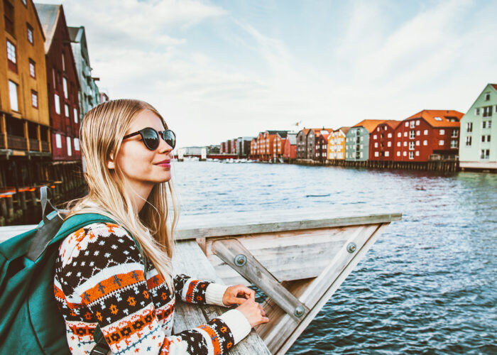 blonde woman traveling in Trondheim city Norway