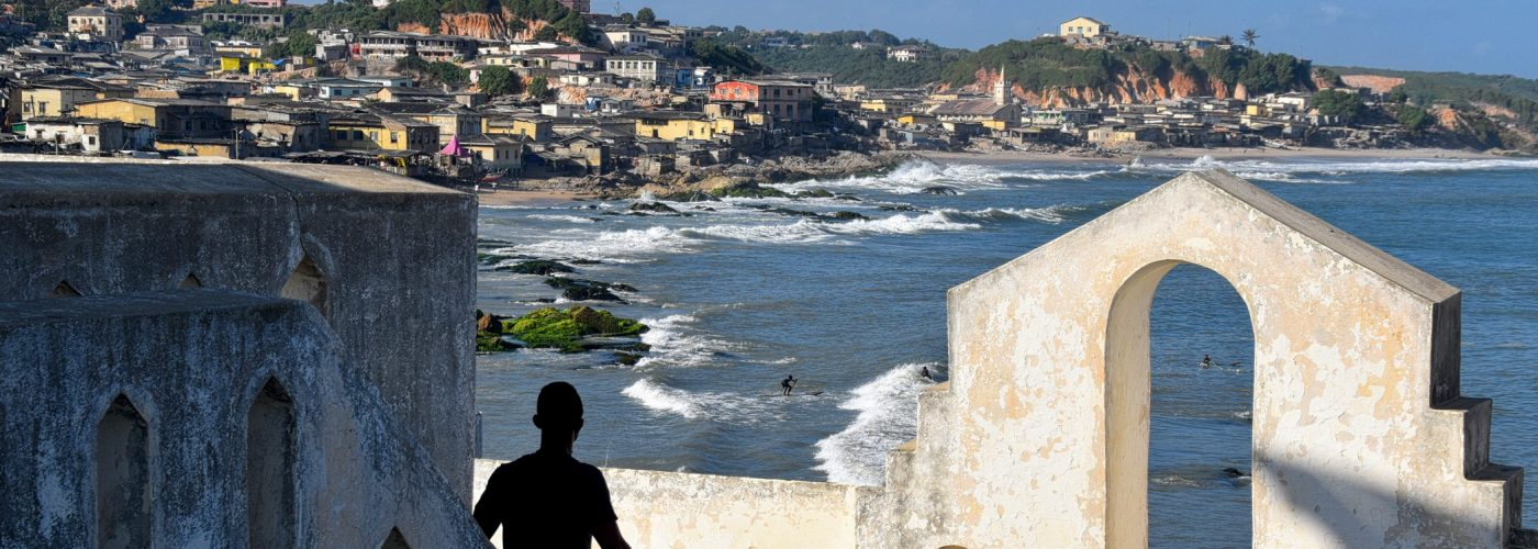 Man looking over coast in Ghana on an ancestry trip