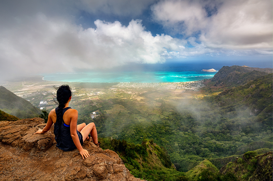 hiker on mountaintop in oahu