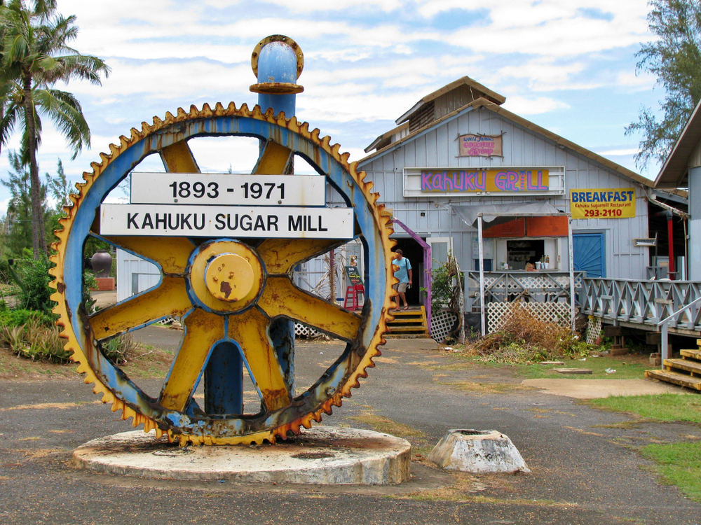 giant machine cog on display at the decommissioned Kahuku sugar mill plantation on the island of Oahu Hawaii