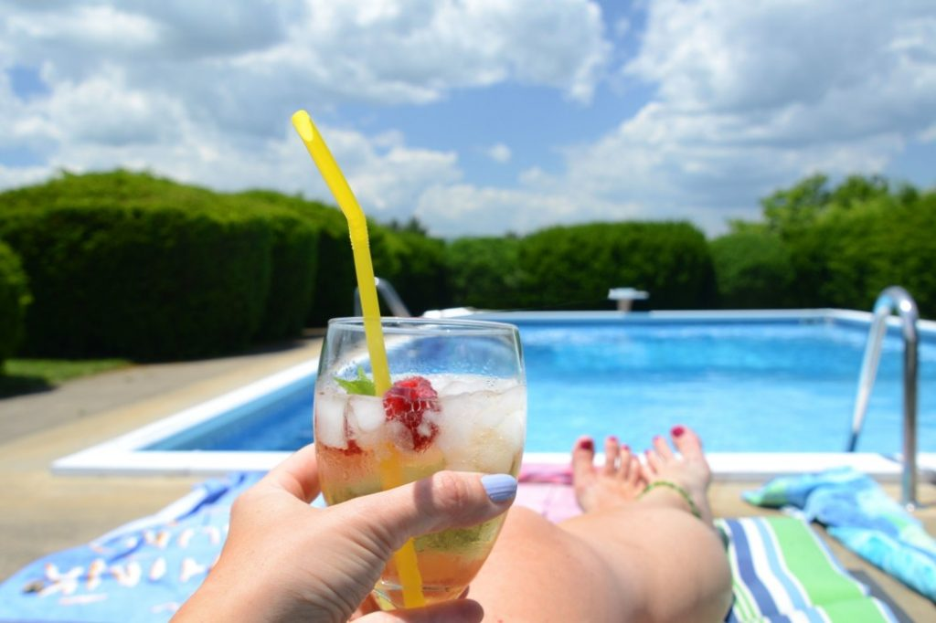 summer-drink-swimming-pool-sunbathing-female-cocktail-pool-beverage-drinking-summertime