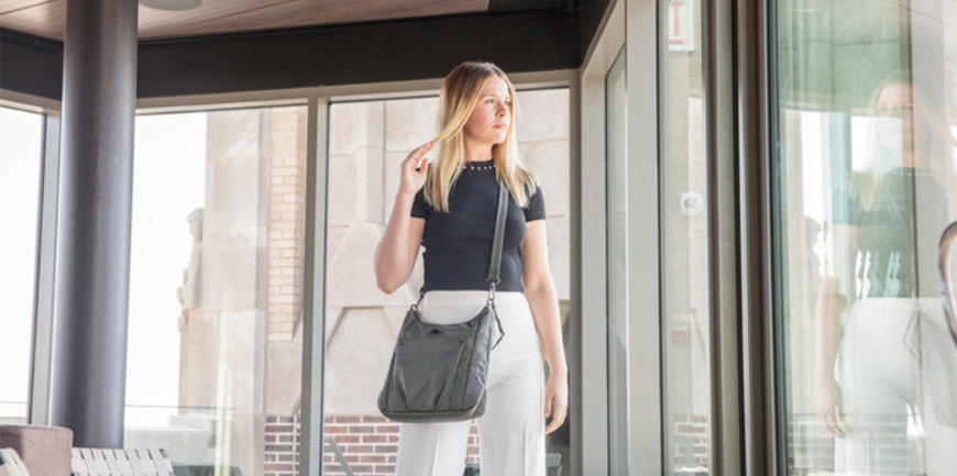 woman with travelon parkview hobo crossbody bag