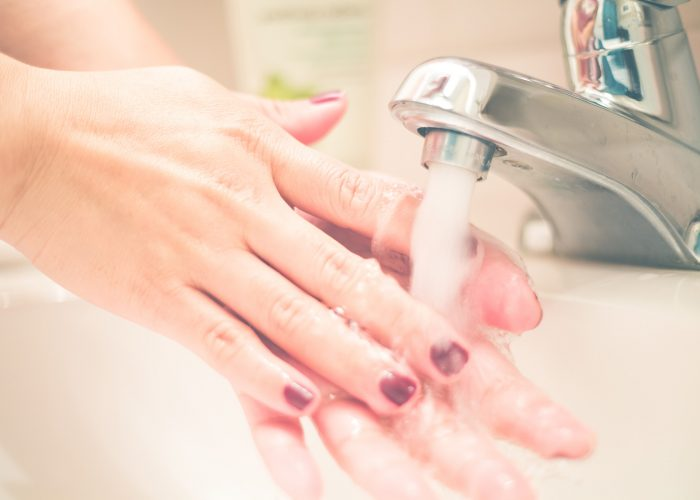 woman washing hands