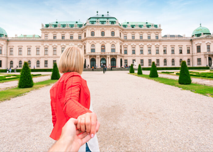 young woman pulling hand belvedere vienna austria.