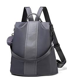 Grey backpack with pom pom