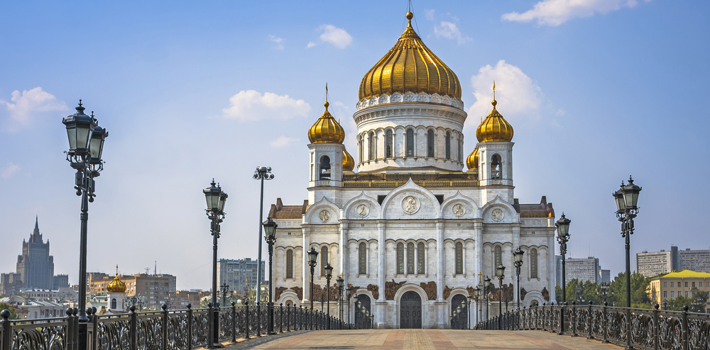 white church with gold-colored dome in moscow, russia