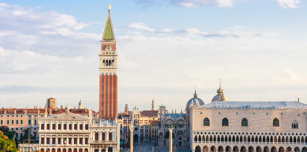 the red-bricked campanile tower rises over the skyline of venice