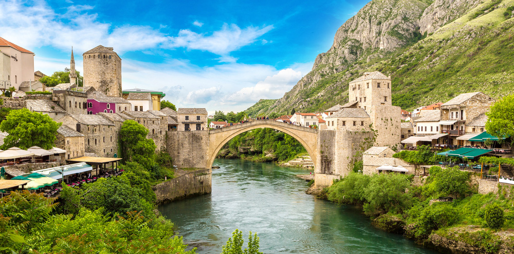 a view of mostar, a city in bosnia overlooking the stari most bridge that flies high above river