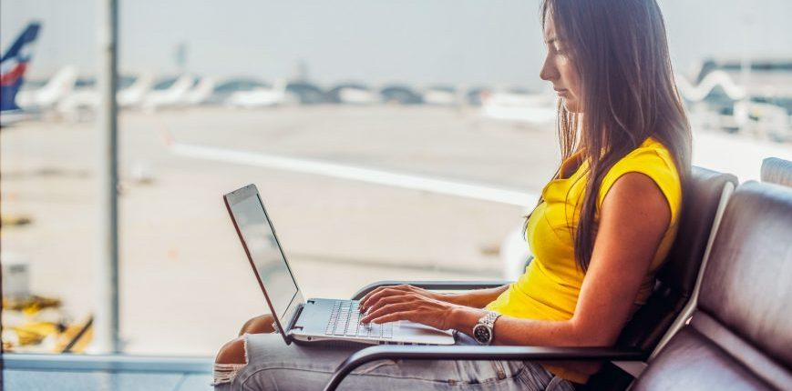 woman using laptop airport wifi