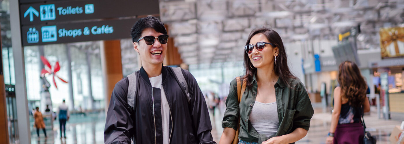 couple in sunglasses at airport.
