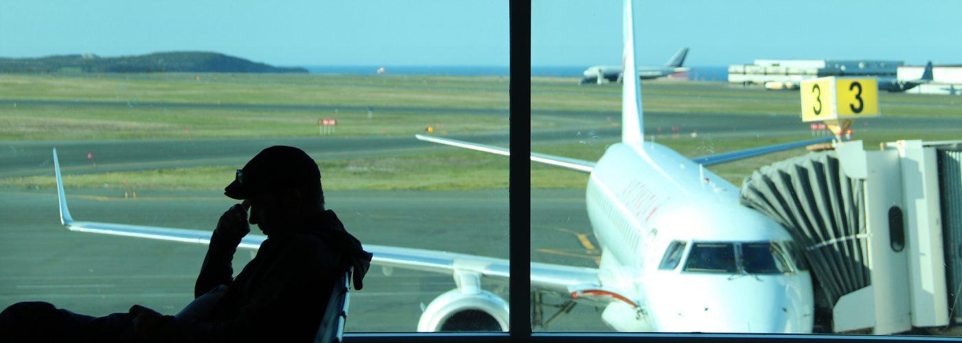 man at airport gate