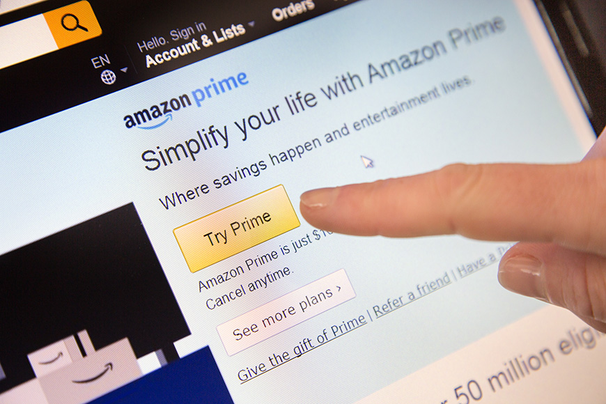Amazon sign in page of website with a finger touching the screen