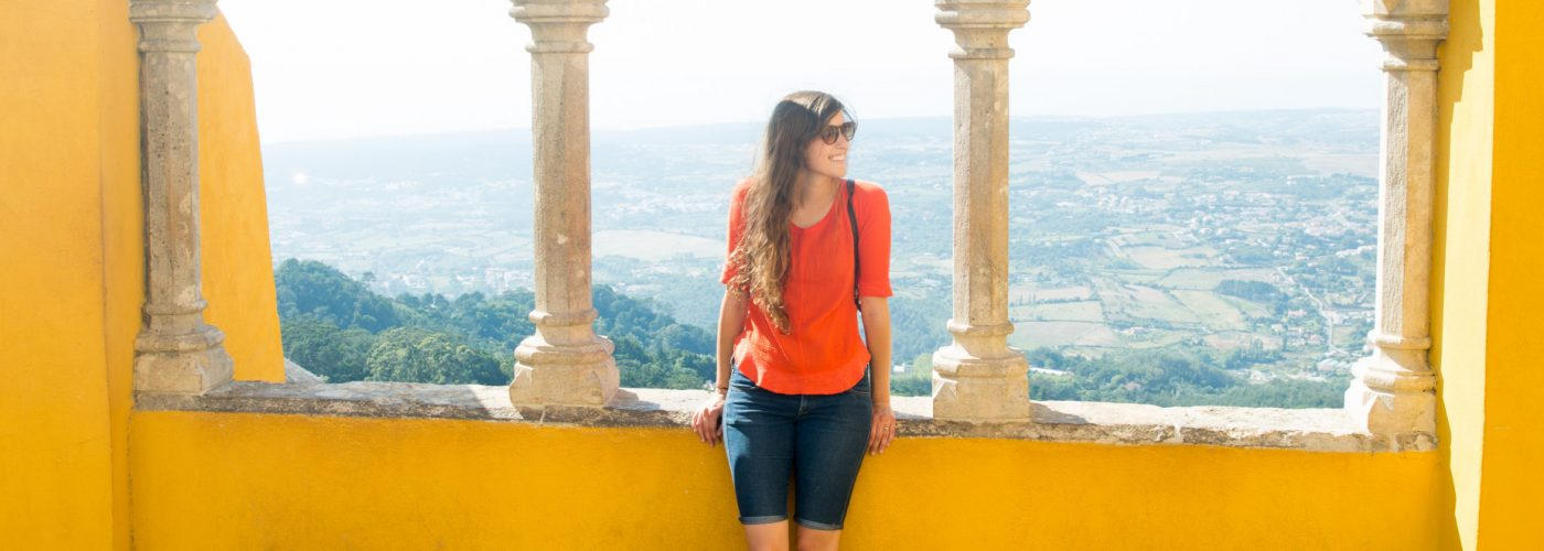 woman standing in european city