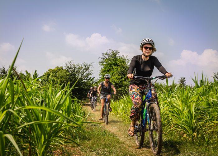 woman riding bike in vietnam on trip