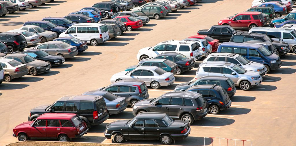 cars parked long term parking lot airport