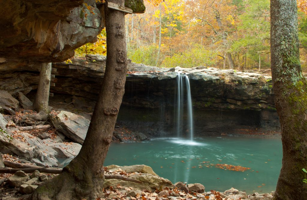 waterfall and swimming hole in forest autumn