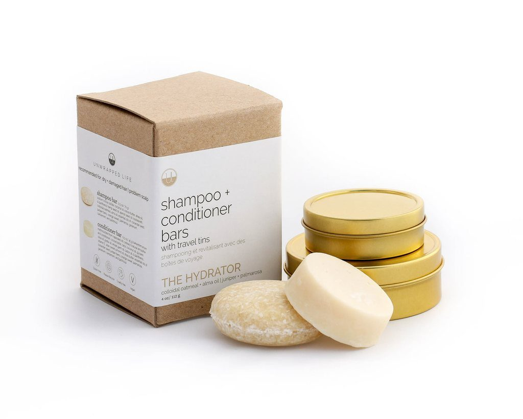 Unwrapped shampoo + conditioner bar travel set with tins