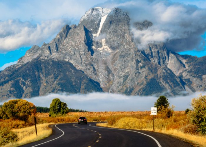 grand teton national park road with mountain background