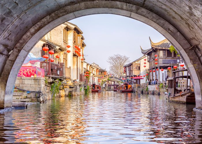 view from beneath canal bridge in Suzhou, China.