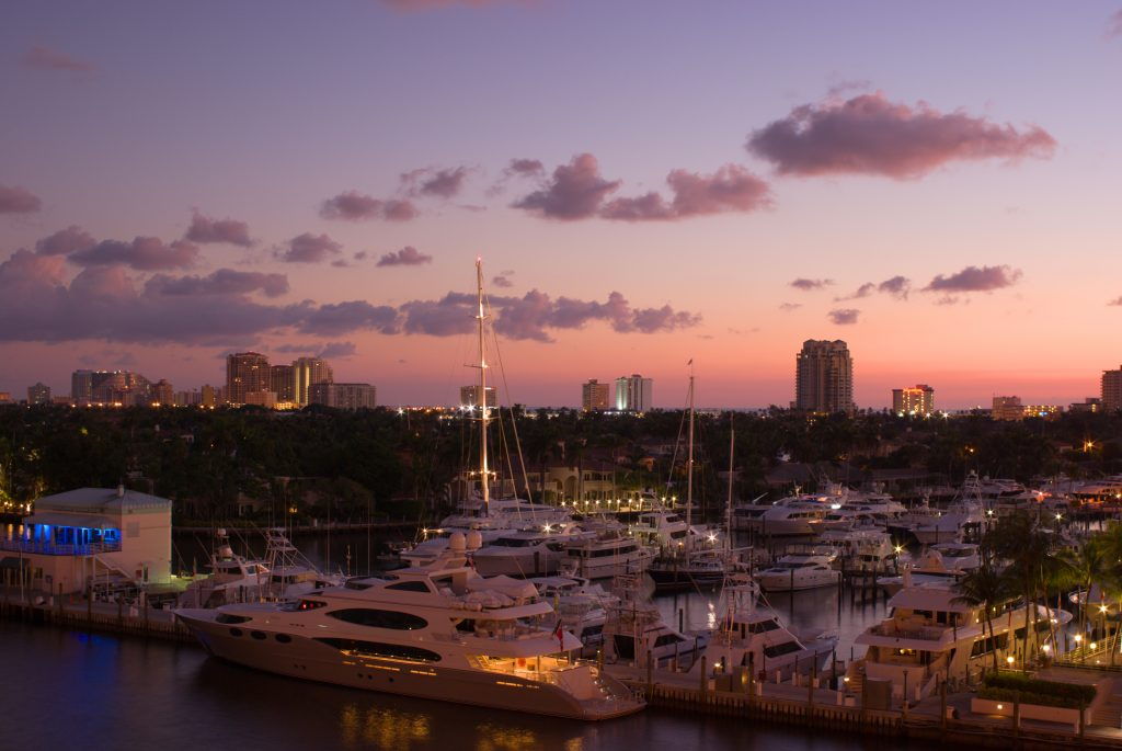 boats in fort lauderdale harbor at dusk.