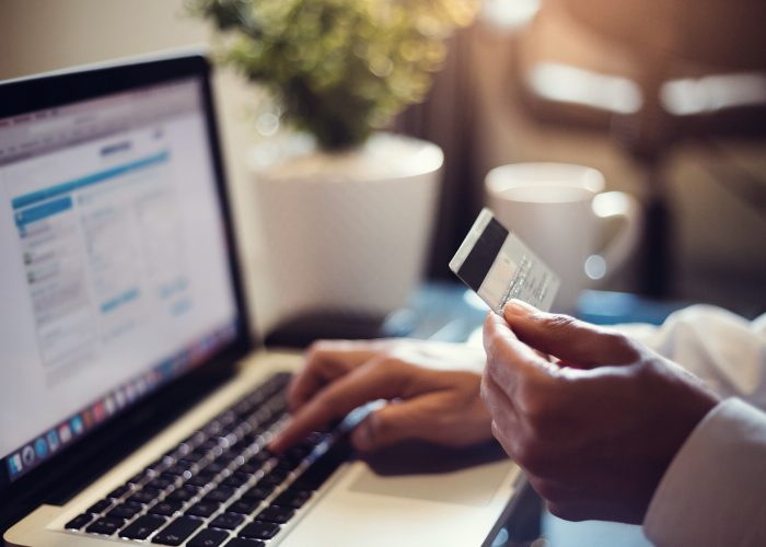 online purchase on laptop with travel card