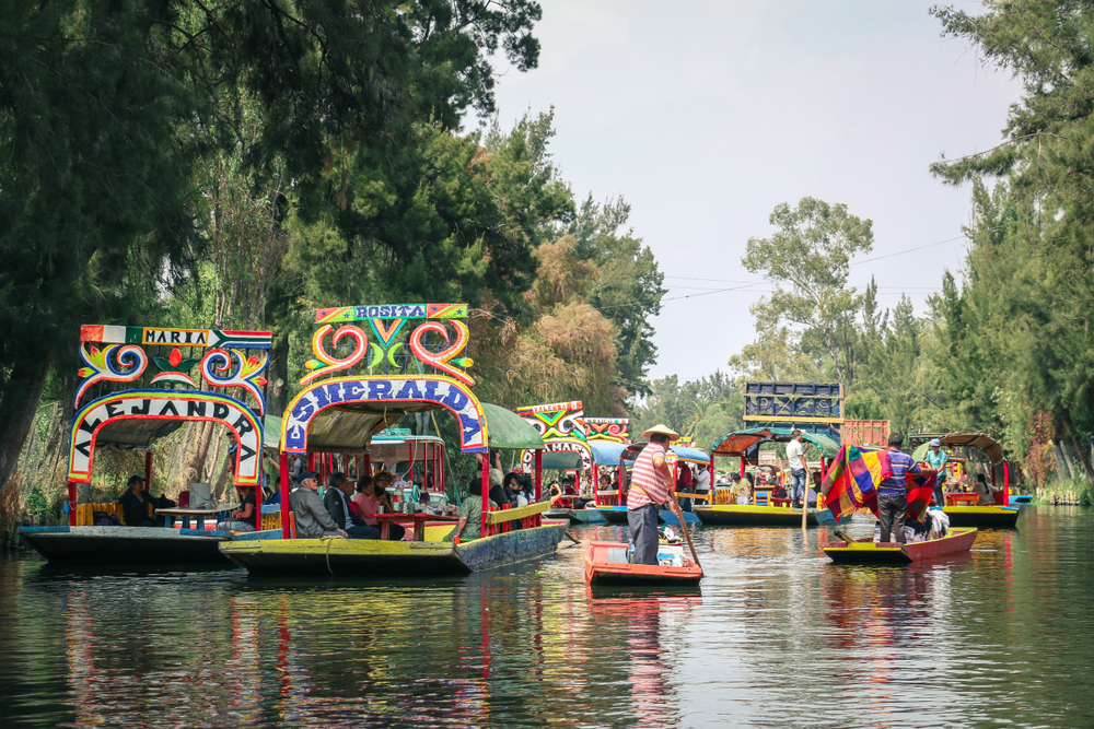 colorful river boats along a canal.