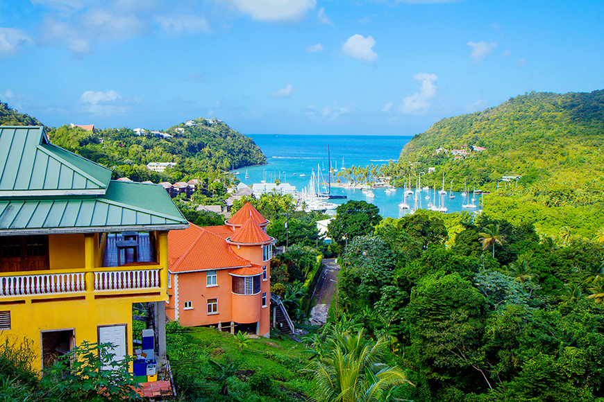 st lucia colorful houses and harbor with boats.