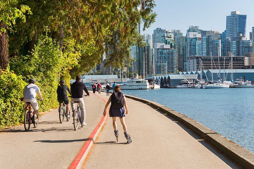 roller blader and bikers in stanley park vancouver.