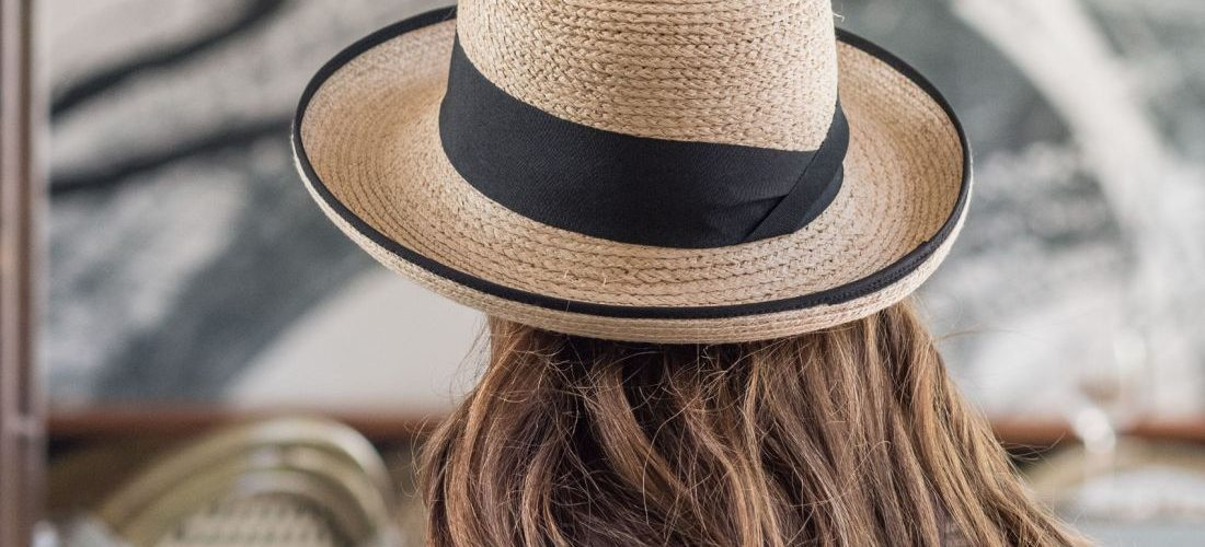 Person wearing Tilley Rebecca Straw Sun Hat