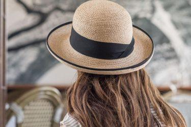 Person wearing Tilley Rebecca Straw Sun Hat