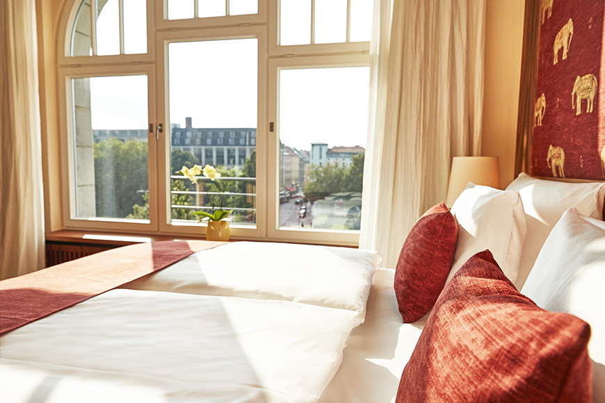 Hotel orania berlin orania.50 size room detailed window and bed view.