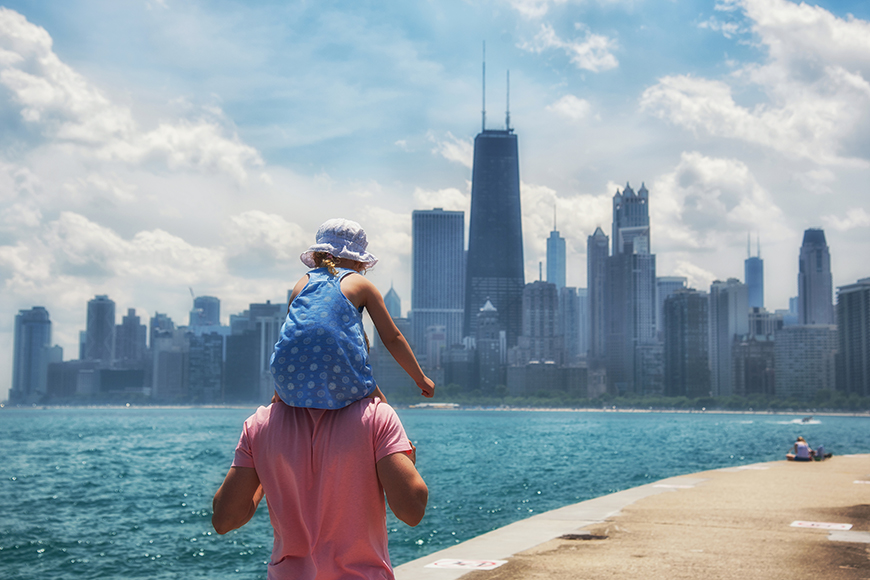 chicago waterfront father carrying child.