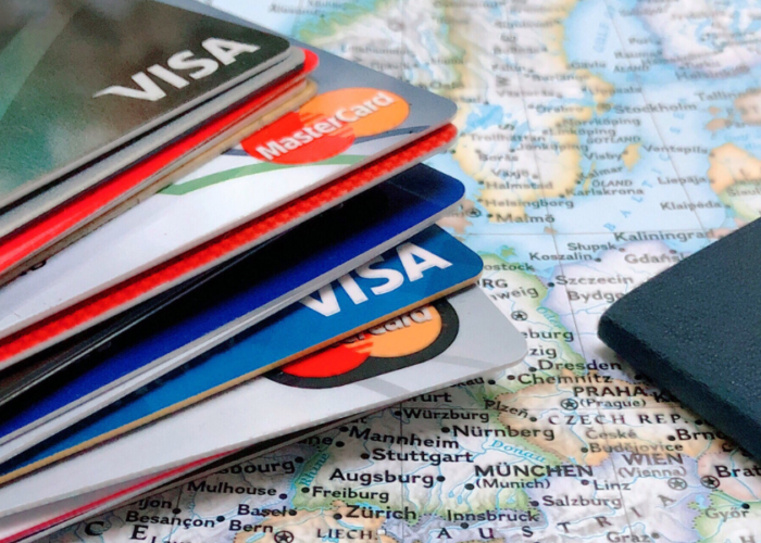 passport and credit cards on map.