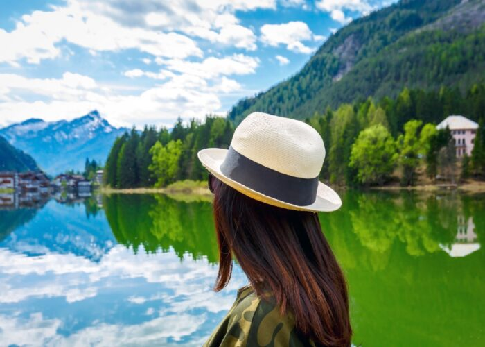 female traveler looking out at lake.