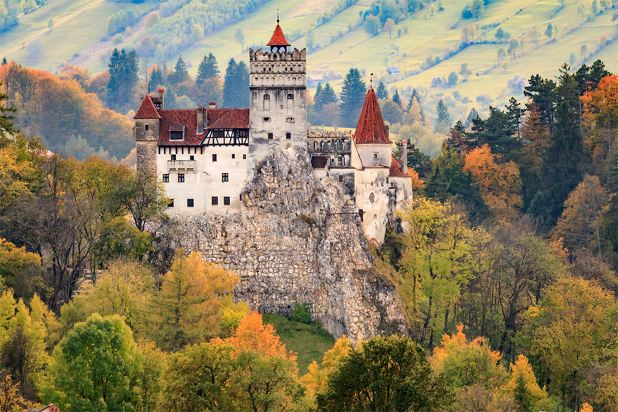fall foliage at dracula's castle, romania.