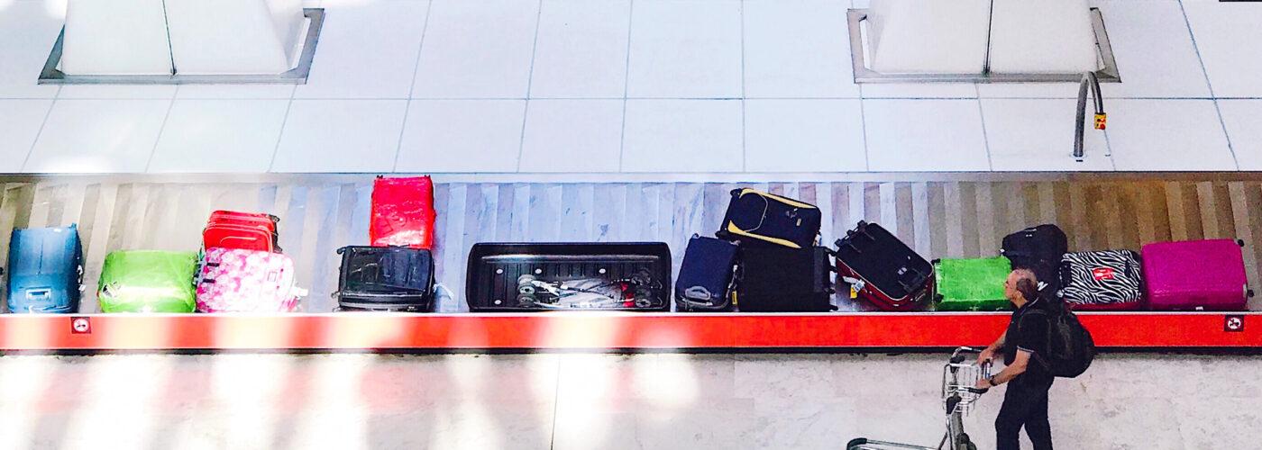 baggage claim belt luggage man claiming