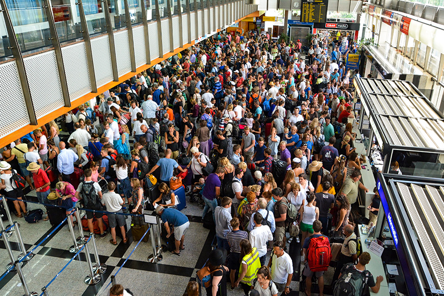 crowd of passengers in the departure hall airport