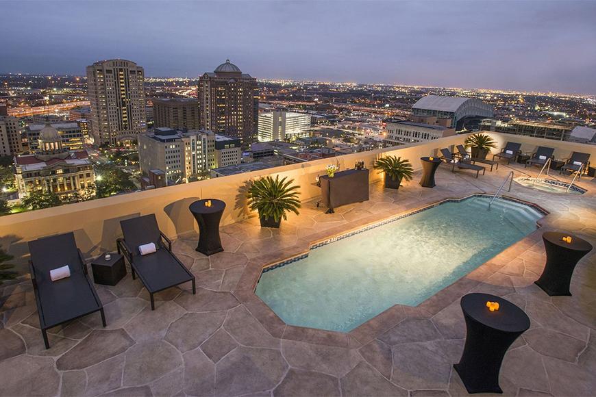 magnolia hotel houston rooftop pool at night.