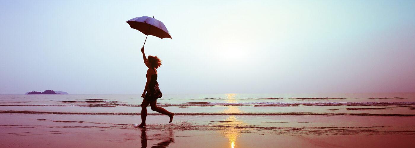 woman umbrella beach