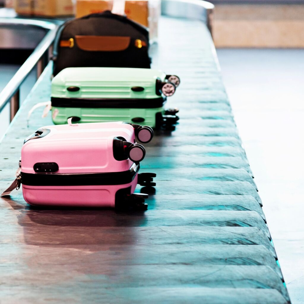 suitcases on conveyor belt