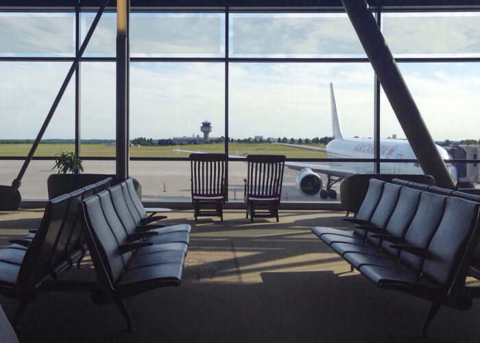 empty airport waiting area airplane out window