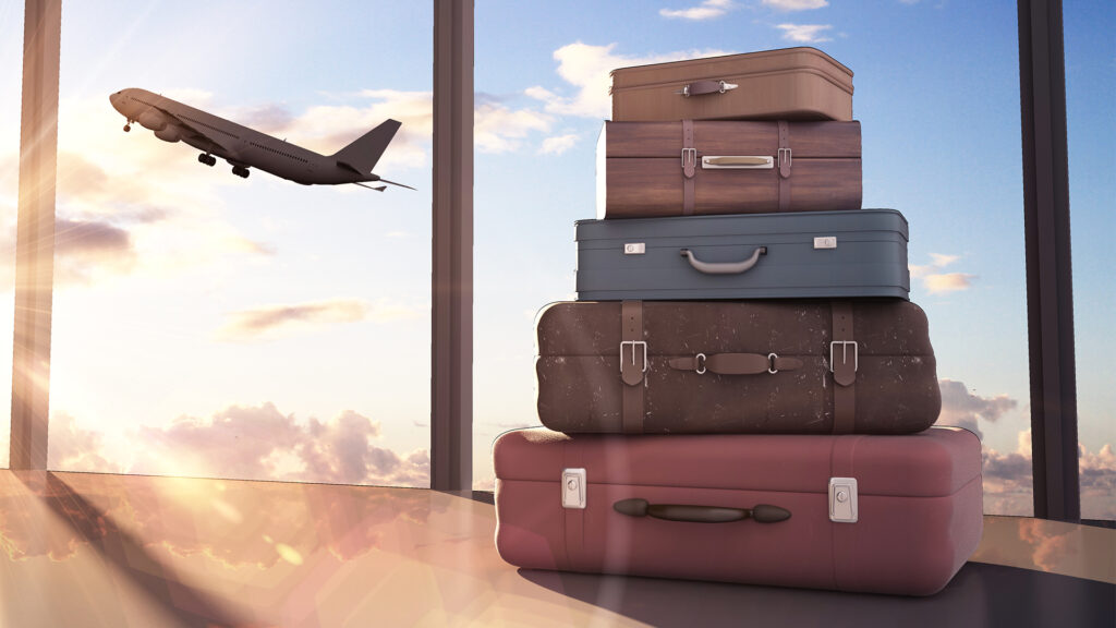 suitcases with plane in background