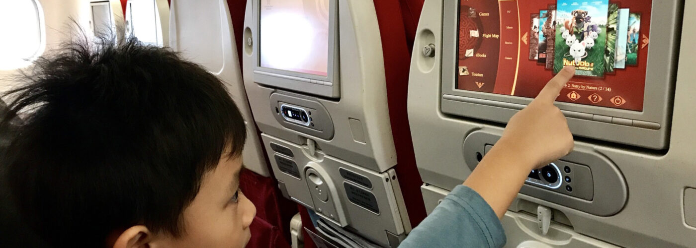 child watching tv on airplane contributor use