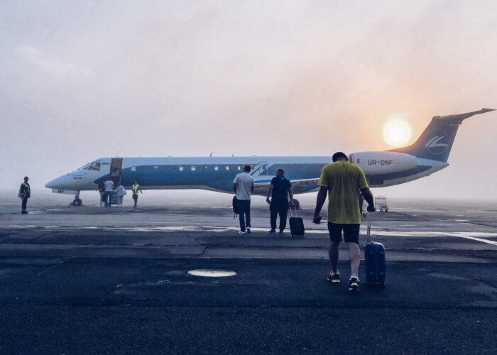 man boarding airplane jet early morning
