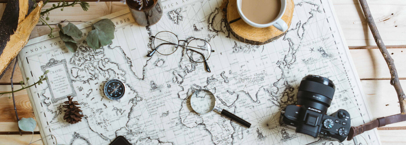 map planning camera coffee travel