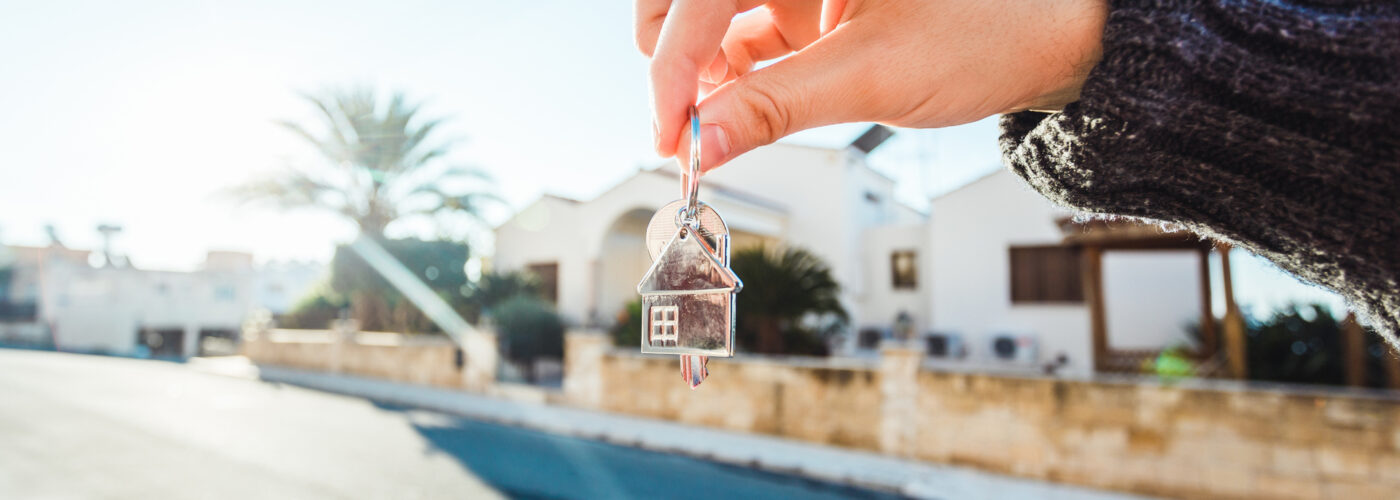 hand holding set of house keys.